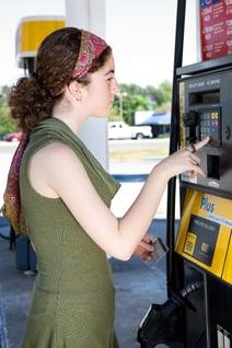 girl at fuel pump.jpg